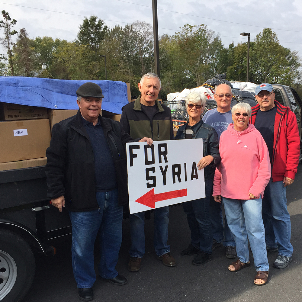UUSDers with truck loaded with donations for the Syrian refugees